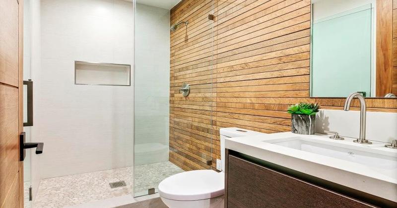 Bathroom with wood walls