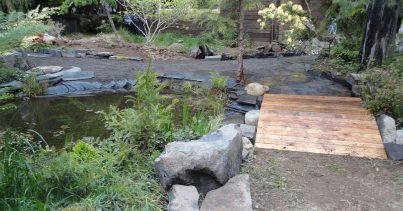 Flat wooden garden bridge
