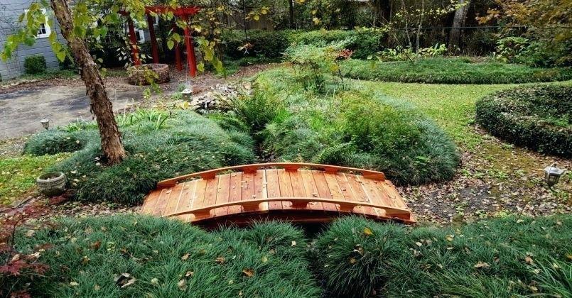 Miniature wooden garden bridge
