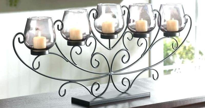 Wrought iron fireplace candle holder
