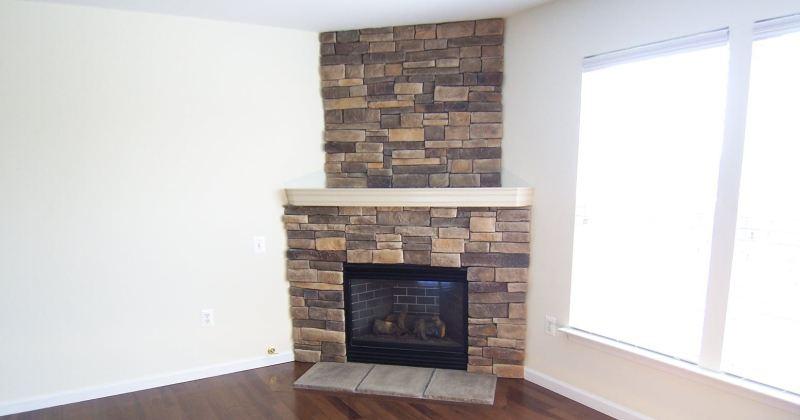 Corner gas fireplace with stone surround