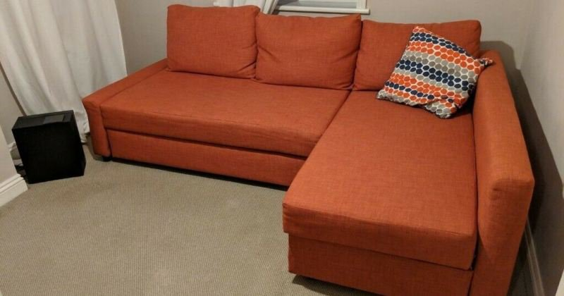 Orange ikea sofa bed
