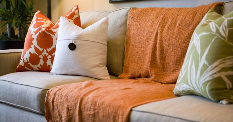 Orange sofa throw