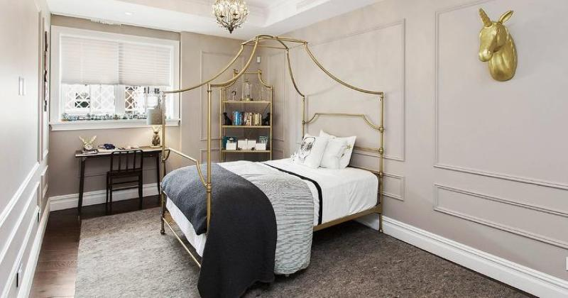 Bedroom with gold canopy bed