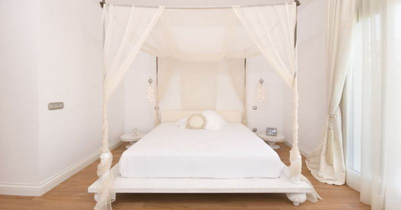 White bedroom canopy bed