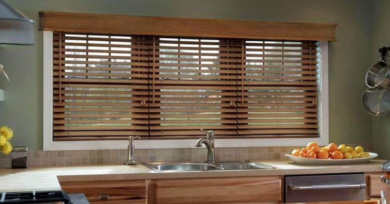 Wooden venetian blinds in kitchen