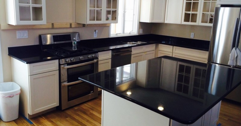 White kitchens with black honed granite